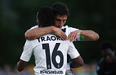 Lars Stindl of Moenchengladbach celebrates with team mate Ibrahim Traore after scoring his team's 3rd goal during the friendly match between Borussia...