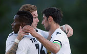 Lars Stindl of Moenchengladbach celebrates with team mates Andre Hahn and Ibrahim Traore after scoring his team's 3rd goal during the friendly match...