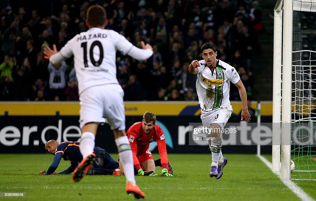 Lars Stindl of Moenchengladbach celebrates with Thorgan Hazard of Moenchengladbach after scoring his teams first goal during the Bundesliga match...