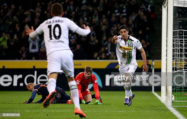 Lars Stindl of Moenchengladbach celebrates with Thorgan Hazard of Moenchengladbach after scoring his teams first goal during the Bundesliga match...