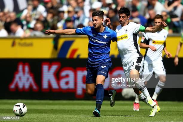 Lars Stindl of Moenchengladbach challenges Antonio Colak of Darmstadt during the Bundesliga match between Borussia Moenchengladbach and SV Darmstadt...