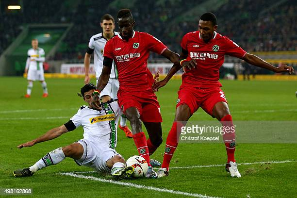 Lars Stindl of Moenchengladbach challenges Salif Sane and Marcelo of Hannover during the Bundesliga match between Borussia Moenchengladbach and...