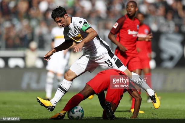 Lars Stindl of Moenchengladbach fights for the ball with Jetro Willems of Frankfurt during the Bundesliga match between Borussia Moenchengladbach and...