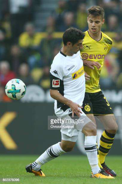 Lars Stindl of Moenchengladbach fights for the ball with Julian Weigl of Dortmund during the Bundesliga match between Borussia Dortmund and Borussia...