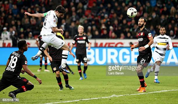 Lars Stindl of Moenchengladbach heads his teams second goal during the Bundesliga match between Bayer 04 Leverkusen and Borussia Moenchengladbach at...