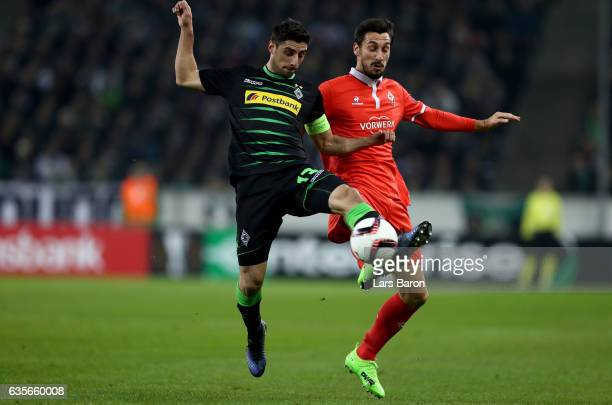 Lars Stindl of Moenchengladbach is challenged by Davide Astori of Fiorentina during the UEFA Europa League Round of 32 first leg match between...