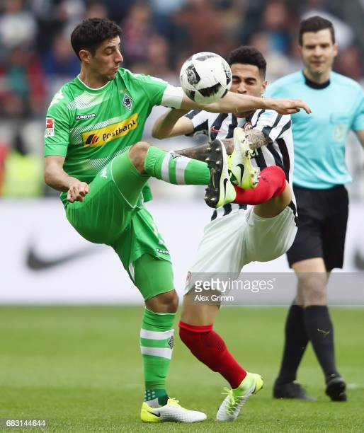 Lars Stindl of Moenchengladbach is challenged by Omar Mascarell of Frankfurt during the Bundesliga match between Eintracht Frankfurt and Borussia...