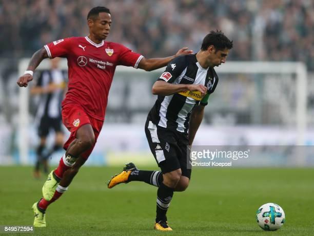 Lars Stindl of Moenchengladbach is chased by Dennis Aogo of Stuttgart during the Bundesliga match between Borussia Moenchengladbach and VfB Stuttgart...