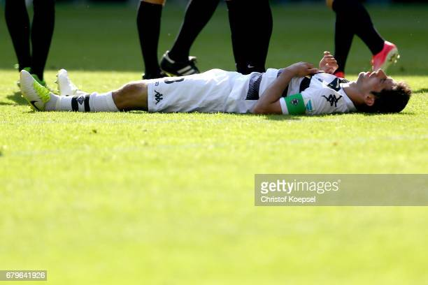 Lars Stindl of Moenchengladbach lies on the pitch during the Bundesliga match between Borussia Moenchengladbach and FC Augsburg at BorussiaPark on...