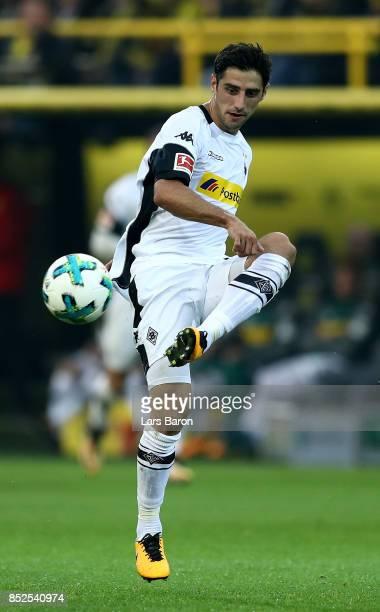Lars Stindl of Moenchengladbach runs with the ball during the Bundesliga match between Borussia Dortmund and Borussia Moenchengladbach at Signal...