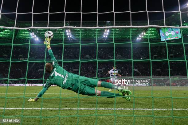 Lars Stindl of Moenchengladbach scores a goal to make it 10 during penalty shoot out against Lukas Hradecky goal keeper of Frankfurt during the DFB...