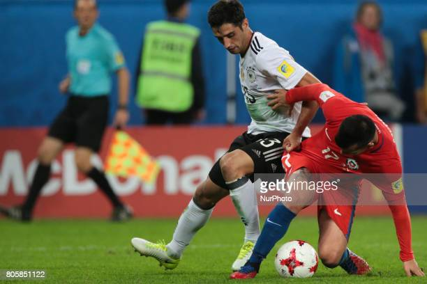Lars Stindl of the Germany national football team and Gary Medel of the Chile national football team vie for the ball during the 2017 FIFA...