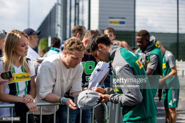 Lars Stindl sign for the supporters after a training session of Borussia Moenchengladbach at BorussiaPark on July 26 2017 in Moenchengladbach Germany