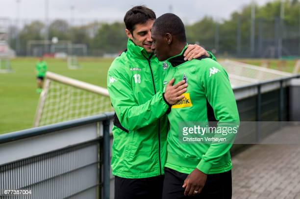 Lars Stindl welcomes Mamadou Doucoure during a rehab training session at BorussiaPark on May 03 2017 in Moenchengladbach Germany