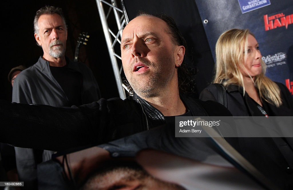 Lars Ulrich (C), drummer of the band Metallica, arrives for the fifth Metal Hammer Awards at Kesselhaus on September 13, 2013 in Berlin, Germany. The annual prizes are given by Metal Hammer, a German music magazine specialized in Heavy Metal and Hard Rock.