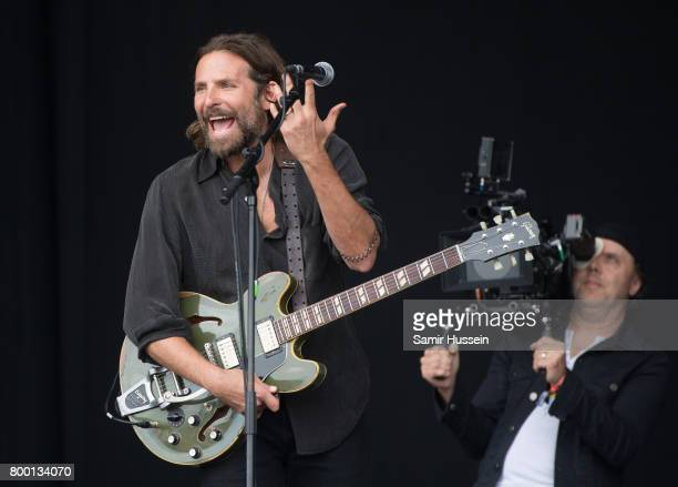 Lars Ulrich films Bradley Cooper as he performs on the Pyramid Stage for a film on day 2 of the Glastonbury Festival 2017 at Worthy Farm Pilton on...