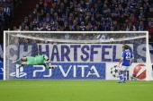 Lars Unnerstaallnd Christian Fuchs of Schalke get the first goal during the UEFA Champions League group B match between FC Schalke 04 and Montpellier...