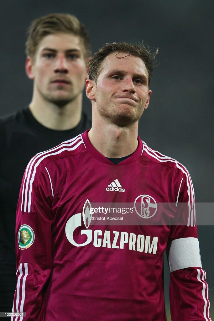 Lars Unnerstall and Benedikt Hoewedes of Schalke look dejected after losing the DFB Cup round of sixteen match between Borussia Moenchengladbach and FC Schalke 04 at Borussia Park Stadium on December 21, 2011 in Moenchengladbach, Germany. The match between Gladbach and Schalke ended 3-1.