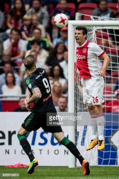 Lars Veldwijk of FC Groningen Nick Viergever of Ajax during the Dutch Eredivisie match between Ajax Amsterdam and FC Groningen at the Amsterdam Arena...