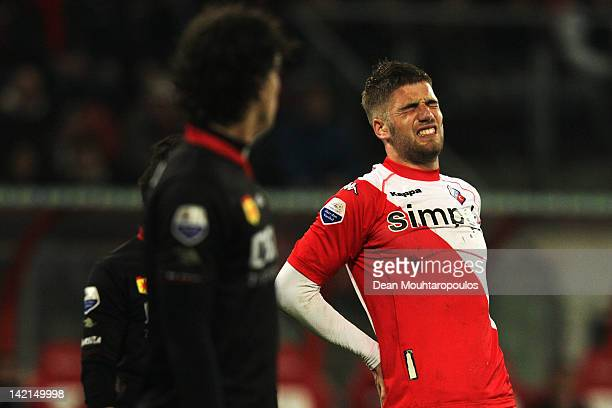 Lars Veldwijk of Utrecht holds his back in pain during the Eredivisie match between FC Utrecht and SC Excelsior Rotterdam at Stadion Galenwaard on...