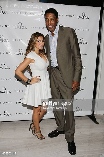 Larsa Pippen and Scottie Pippen pose during the Haute Living OMEGA Dark side of the Moon Watch event hosted by Larsa and Scottie Pippen on December 4...