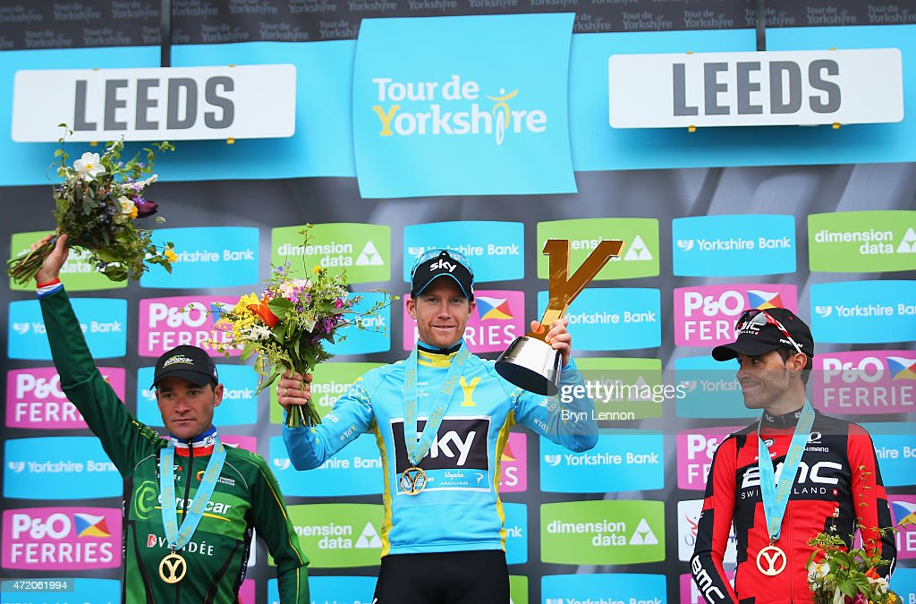 LarsPetter Nordhaug of Norway and Team Sky celebrates on the podium after his overall victory with second place Samuel Sanchez of Spain and BMC...