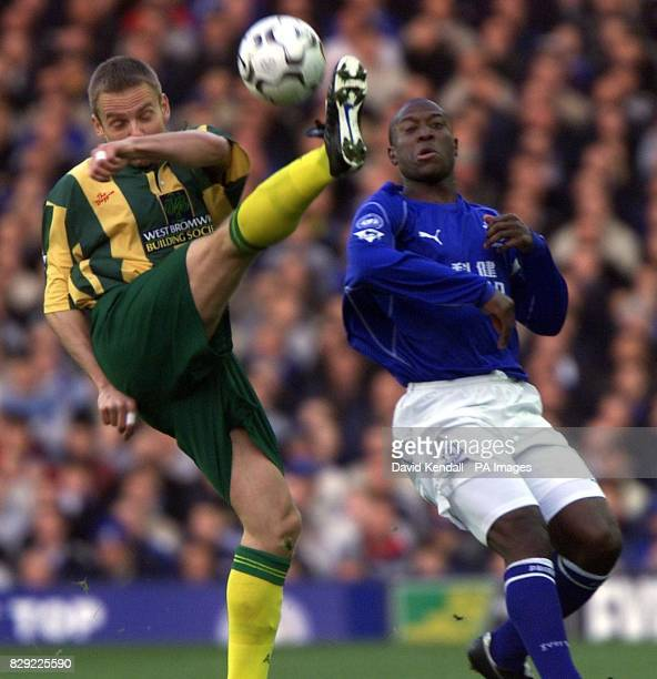 Larus Sigurdsson of West Bromwich Albion clears as Everton's Kevin Campbell moves in during their FA Barclaycard Premiership match at Everton's...