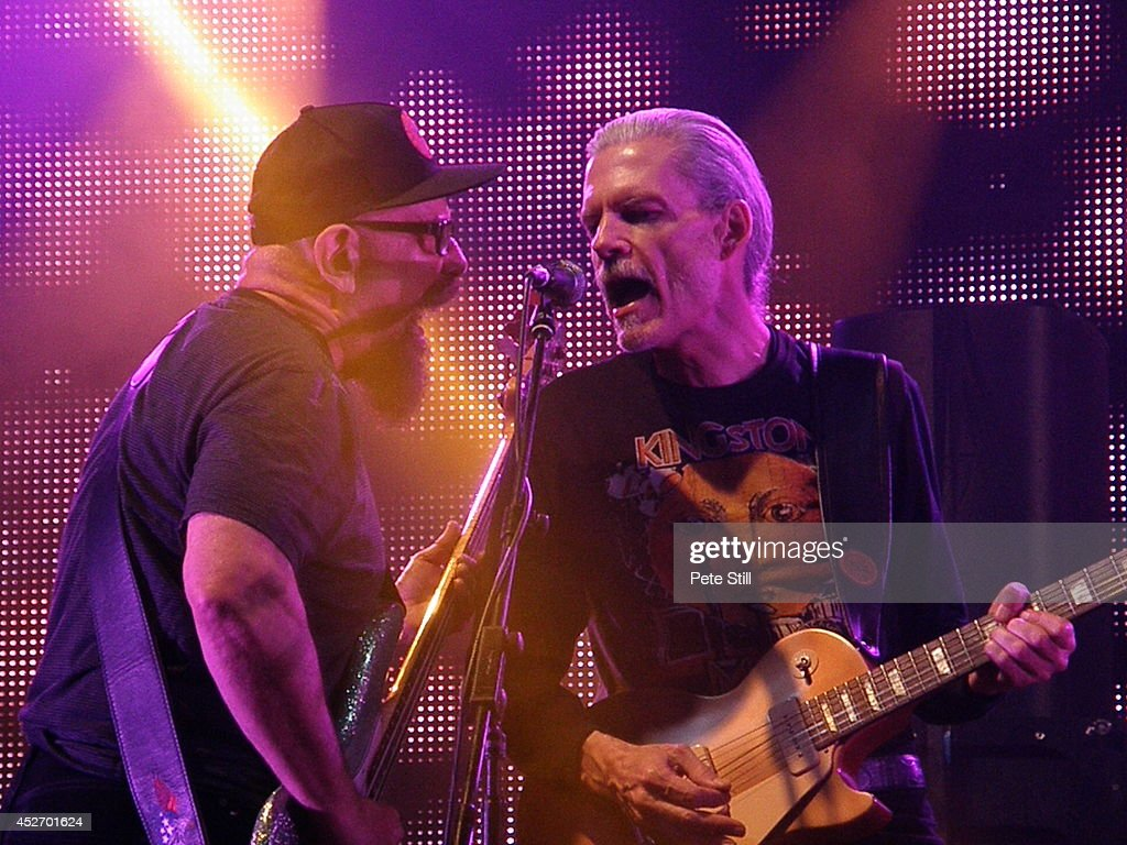 Lary Taylor and John Paulus of Canned Heat perform on stage at the Silverstone Classic at Silverstone on July 25, 2014 in Northampton, United Kingdom.