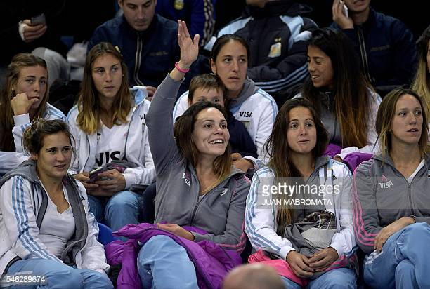 Las Leonas Argentina's hockey team player Noel Barrionuevo waves next to teammate before the arrival of Argentine President Mauricio Macri to the...
