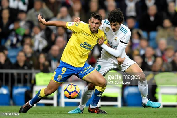 Las Palmas' Argentinian forward Jonathan Calleri challenges Real Madrid's Spanish defender Jesus Vallejo during the Spanish league football match...