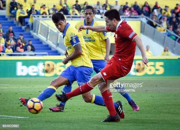 Las Palmas' defender Aythami Artiles vies with Sevilla's French midfielder Samir Nasri beside Las Palmas' midfielder Angel Montoro during the Spanish...