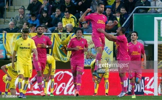 Las Palmas' defender David Garcia celebrates a goal with teammates during the Spanish league football match Villarreal CF vs las UD Las Palmas at El...