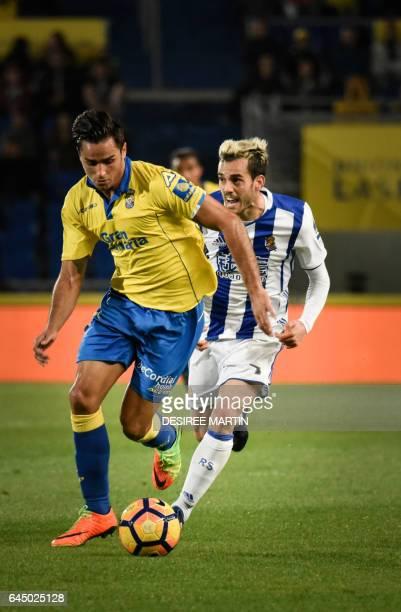 Las Palmas' defender David Simon vies Real Sociedad's midfielder Juanmi during the Spanish league football match UD Las Palmas vs Real Sociedad at...