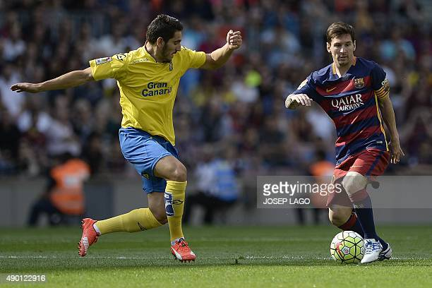 Las Palmas' defender Pedro Bigas Rigo vies with Barcelona's Argentinian forward Lionel Messi during the Spanish league football match FC Barcelona vs...