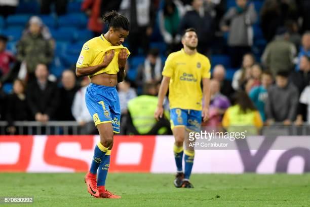 Las Palmas' Fench forward Loic Remy and Las Palmas' Argentinian forward Jonathan Calleri react at the end of the Spanish league football match Real...