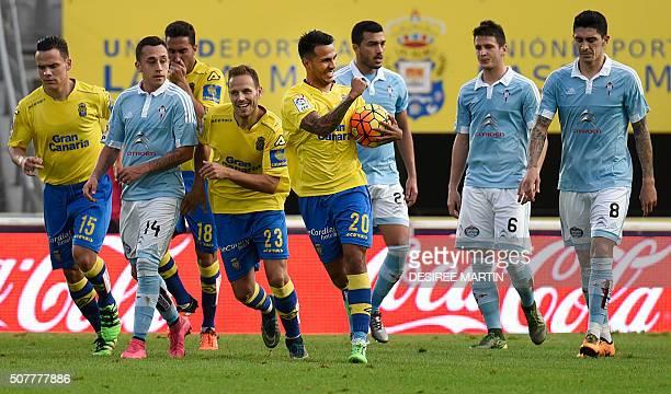Las Palmas' forward Jonathan Viera celebrates a goal with Las Palmas' defender Daniel Castellano Betancor next to Celta Vigo's Chilean forward Fabian...