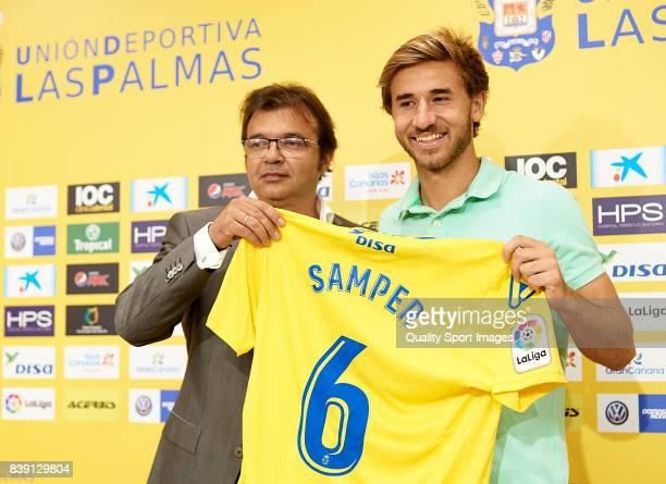 Las Palmas General Manager Toni Cruz and Sergi Samper during his official presentation as a new player for UD Las Palmas at Estadio Gran Canaria on...