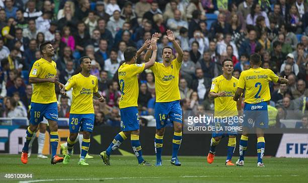 Las Palmas' midfielder Hernan celebrates his goal during the Spanish league football match Real Madrid CF vs UD Las Palmas at the Santiago Bernabeu...