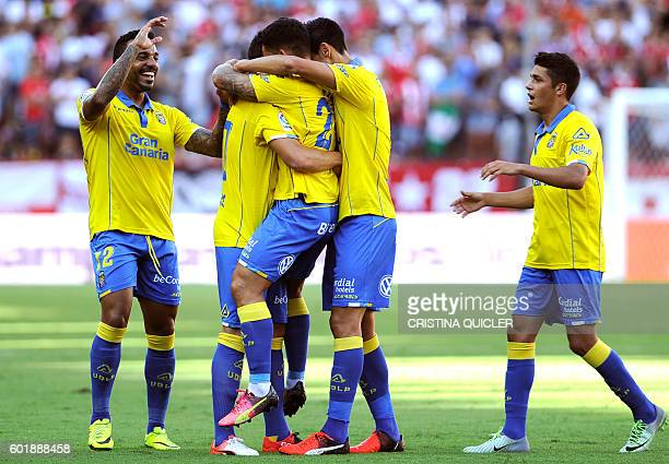 Las Palmas' midfielder Tana Dominguez celebrates a goal with teammates during the Spanish league football match Sevilla FC vs UD Las Palmas at the...