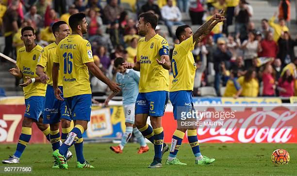 Las Palmas' players celebrate a goal during the Spanish league football match UD Las Palmas vs Celta de Vigo at the Las Palmas stadium in Las Palmas...