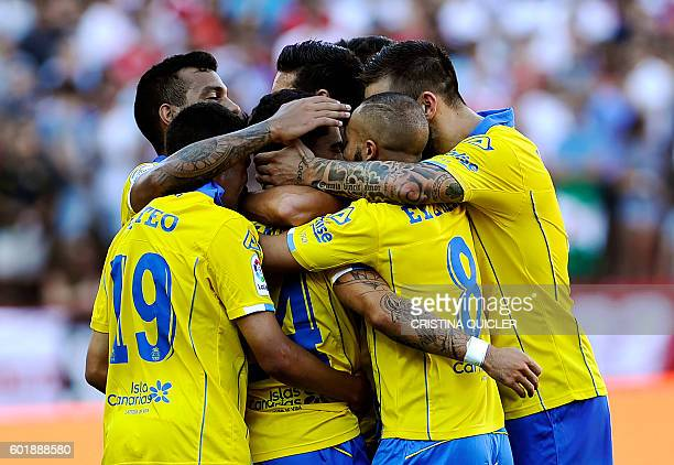 Las Palmas' players celebrate a goal during the Spanish league football match Sevilla FC vs UD Las Palmas at the Ramon Sanchez Pizjuan stadium in...