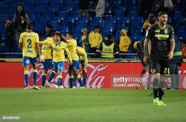 Las Palmas' players celebrate a goal during the Spanish league football match UD Las Palmas vs Villarreal CF at the Gran Canaria stadium in Las...