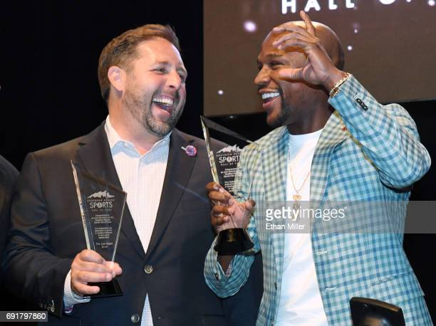 Las Vegas Bowl Executive Director John Saccenti and boxer Floyd Mayweather Jr talk after the annual football game and Mayweather were both inducted...