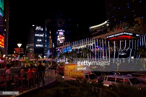 Las Vegas by Night. People and traffic along the street : Stock Photo