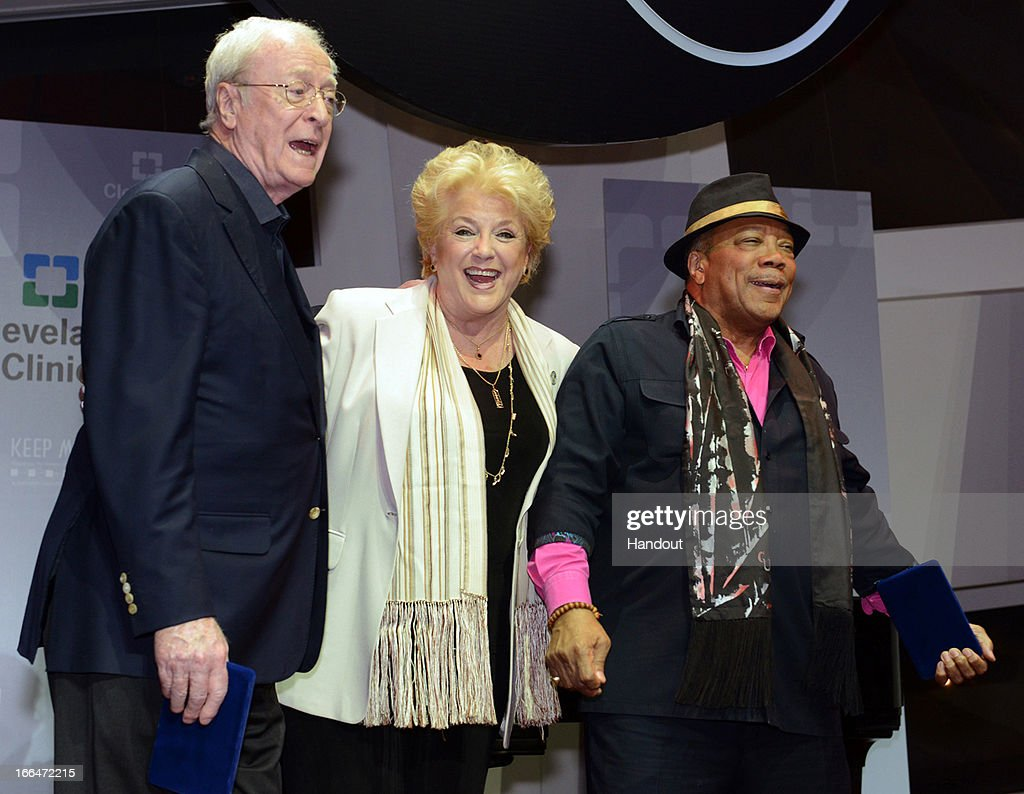 Las Vegas Mayor Carolyn G. Goodman (C) presents film and music luminaries Sir Michael Caine and Quincy Jones with a key to the City in celebration of their 80th birthdays on April 12, 2013 in Las Vegas, California.. A star-studded birthday celebration on April 13 at the 17th annual Keep Memory Alive Power of Love Gala at MGM Grand Garden Arena in Las Vegas will raise funds for Cleveland Clinic Lou Ruvo Center for Brain Health and its fight against neurodegenerative brain diseases. Highlights from the night will include tributes from Chaka Khan and Stevie Wonder, Chris Tucker and Whoopi Goldberg. Wonder will lead a 'Happy Birthday' serenade, followed by a performance of 'We are the World', by the entire celebrity lineup.