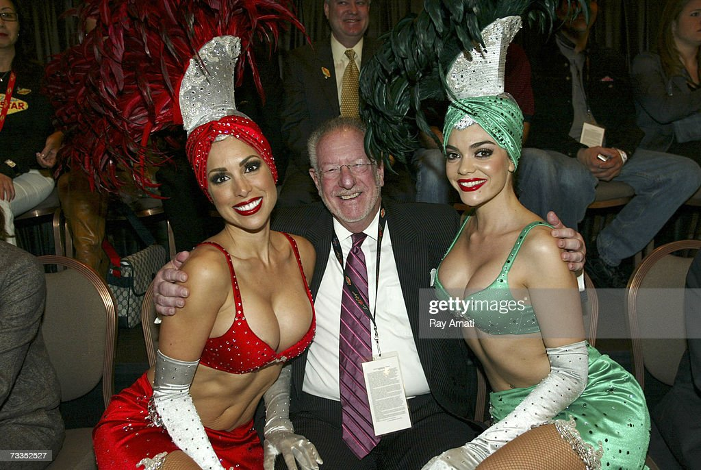 Las Vegas Mayor Oscar Goodman sits court side with two dancers during the McDonald's NBA AllStar Celebrity Game Presented by 2K Sports at NBA Jam...