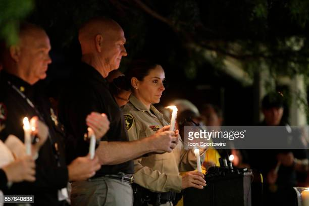 Las Vegas Metropolitan Police Department Capt Sasha Larkin holds a candle during a prayer vigil held at Mountain Crest Park for the victims of Sunday...