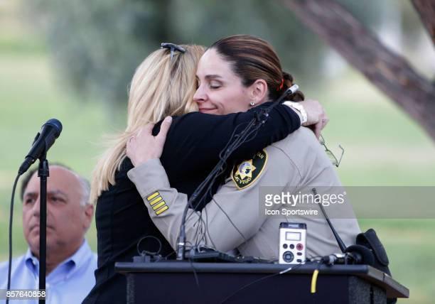 Las Vegas Metropolitan Police Department Capt Sasha Larkin hugs Las Vegas City Councilwoman Michele Fiore during a prayer vigil held at Mountain...