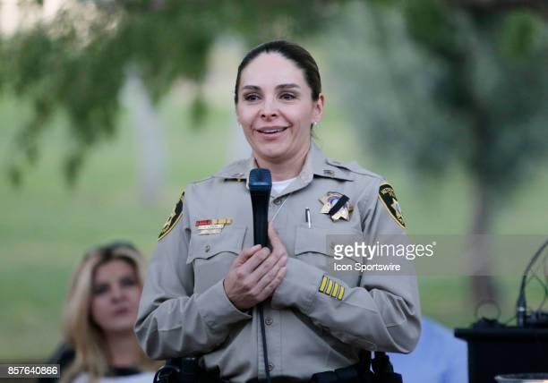 Las Vegas Metropolitan Police Department Capt Sasha Larkin speaks during a prayer vigil held at Mountain Crest Park for the victims of Sunday night's...