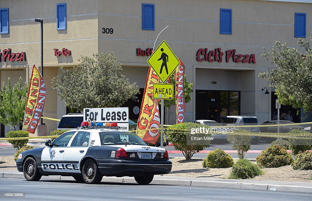 A Las Vegas Metropolitan Police Department car is parked outside CiCi's Pizza where two officers were shot and killed by two assailants on June 8, 2014 in Las Vegas, Nevada. The two suspects then reportedly went into a nearby Wal-Mart where they killed a third person before killing themselves.